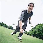 low angle shot of a golfer holding a golf ball and smiling Stock Photo - Premium Royalty-Free, Artist: Cusp and Flirt, Code: 618-01048587
