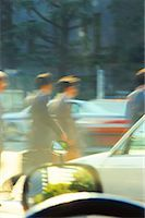 Businesspeople on parking lot (blurred motion) Stock Photo - Premium Royalty-Freenull, Code: 618-01053855