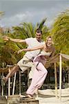 boyfriend and girlfriend walking balancing on logs Stock Photo - Premium Royalty-Free, Code: 627-01068971