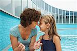 Mother and Daugther by Swimming Pool    Stock Photo - Premium Rights-Managed, Artist: Masterfile, Code: 700-01072146