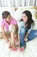 Girls Painting Toenails Together    Stock Photo - Premium Royalty-Freenull, Code: 600-01072252