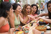 Woman Showing Engagement Ring to Friends at Party    Stock Photo - Premium Rights-Managednull, Code: 700-01072568