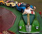Girl Ridding in Austin Car Ride, Carters Steam Fair, England