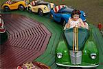 Girl Ridding in Austin Car Ride, Carters Steam Fair, England