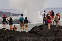 Tourists Standing on Lava, Looking at the Ocean, Hawaii, USA    Stock Photo - Premium Royalty-Freenull, Code: 600-01072971