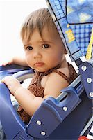 shy baby - Portrait of Baby in Stroller    Stock Photo - Premium Royalty-Freenull, Code: 600-01073132