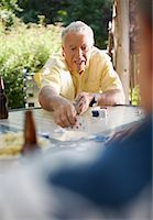 Man Playing Cards Outdoors    Stock Photo - Premium Royalty-Freenull, Code: 600-01073505