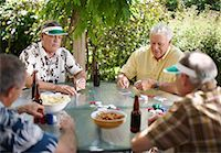 Men Playing Cards Outdoors    Stock Photo - Premium Royalty-Freenull, Code: 600-01073507