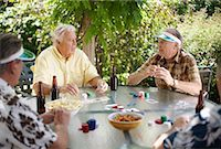 Men Playing Cards Outdoors    Stock Photo - Premium Royalty-Freenull, Code: 600-01073508