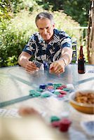 Man Playing Cards Outdoors    Stock Photo - Premium Royalty-Freenull, Code: 600-01073510