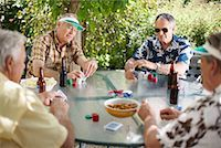 Men Playing Cards Outdoors    Stock Photo - Premium Royalty-Freenull, Code: 600-01073511