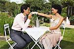 Couple at Restaurant, Man Kissing Woman's Hand