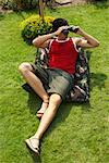 Man Looking Through Binoculars    Stock Photo - Premium Rights-Managed, Artist: Masterfile, Code: 700-01073612