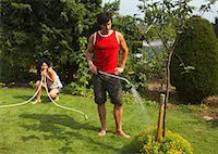 Couple in Garden, Woman Pinching Hose    Stock Photo - Premium Rights-Managednull, Code: 700-01073620