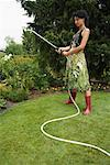 Portrait of Woman Watering Garden    Stock Photo - Premium Rights-Managed, Artist: Masterfile, Code: 700-01073658