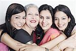 Portrait of four women hugging Stock Photo - Premium Royalty-Freenull, Code: 630-01077865