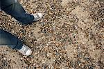 Man's Feet on Gravel Beach    Stock Photo - Premium Rights-Managed, Artist: Masterfile, Code: 700-01082847