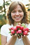 Portrait of Woman Holding Radishes    Stock Photo - Premium Rights-Managed, Artist: Jerzyworks, Code: 700-01083615
