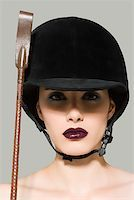 riding crop - Woman in riding gear Stock Photo - Premium Royalty-Freenull, Code: 614-01088531