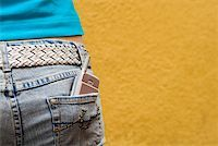 Close-up of a mobile phone in a teenage girl's back pocket Stock Photo - Premium Royalty-Freenull, Code: 625-01093686