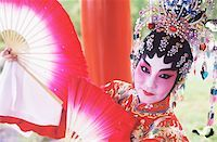 singapore traditional costume lady - Portrait of a female Chinese opera performer holding folding fans, Singapore Stock Photo - Premium Royalty-Freenull, Code: 625-01094635