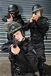 SWAT Officers Holding Weapons    Stock Photo - Premium Rights-Managed, Artist: Hiep Vu, Code: 700-01100164