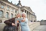 Women Taking Pitcure of Themselves in Front of the Reichstag, Berlin, Germany    Stock Photo - Premium Rights-Managed, Artist: Masterfile, Code: 700-01100255