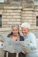 Tourists Looking at Map    Stock Photo - Premium Rights-Managednull, Code: 700-01100259