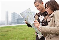 Couple Looking at Map    Stock Photo - Premium Rights-Managednull, Code: 700-01100324