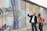 Couple Walking Along the Berlin Wall, Berlin, Germany    Stock Photo - Premium Rights-Managed, Artist: Masterfile, Code: 700-01100339