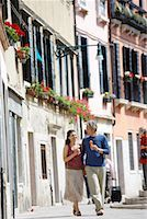 Italy, Venice, couple walking in street holding ice cream cones Stock Photo - Premium Royalty-Freenull, Code: 613-01102116