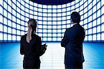 Business People Looking at Video Wall    Stock Photo - Premium Rights-Managed, Artist: Ken Davies, Code: 700-01109918