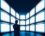 Businessman Looking at Video Wall    Stock Photo - Premium Rights-Managed, Artist: Ken Davies, Code: 700-01109921