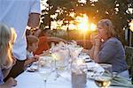 Family Having Dinner Outdoors    Stock Photo - Premium Rights-Managed, Artist: Jerzyworks, Code: 700-01111443