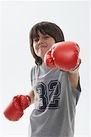 Portrait of Boy Wearing Boxing Gloves    Stock Photo - Premium Royalty-Freenull, Code: 600-01112023
