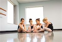 Ballet students adjusting slippers Stock Photo - Premium Royalty-Freenull, Code: 604-01119423