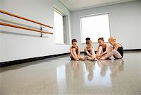 Ballet students adjusting slippers Stock Photo - Premium Royalty-Freenull, Code: 604-01119424