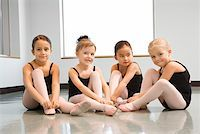 Ballet students adjusting slippers Stock Photo - Premium Royalty-Freenull, Code: 604-01119425