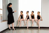 preteen models asian - Ballet instructor addressing students sitting in window Stock Photo - Premium Royalty-Freenull, Code: 604-01119433