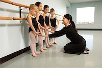 preteen models asian - Ballet instructor correcting students Stock Photo - Premium Royalty-Freenull, Code: 604-01119436