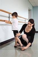 pre-teen boy models - Ballet instructor correcting boy's position Stock Photo - Premium Royalty-Freenull, Code: 604-01119441
