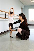pre-teen boy models - Ballet instructor correcting boy's position Stock Photo - Premium Royalty-Freenull, Code: 604-01119442