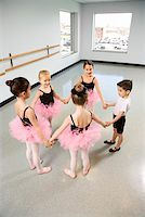 preteen models asian - Ballet students standing in a circle and holding hands Stock Photo - Premium Royalty-Freenull, Code: 604-01119447