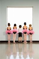 pre-teen boy models - Rear view of ballet students standing by window Stock Photo - Premium Royalty-Freenull, Code: 604-01119450