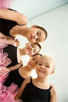 preteen models asian - Low angle portrait of girls in ballet class Stock Photo - Premium Royalty-Freenull, Code: 604-01119460