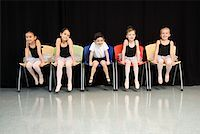 preteen models asian - Ballet students sitting in a row Stock Photo - Premium Royalty-Freenull, Code: 604-01119493