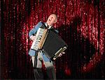 Man Playing Accordion on Stage    Stock Photo - Premium Rights-Managed, Artist: Masterfile, Code: 700-01120509