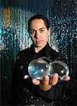 Magician on Stage with Crystal Balls    Stock Photo - Premium Rights-Managed, Artist: Masterfile, Code: 700-01120549