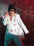Elvis Impersonator on Stage