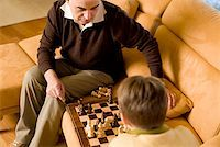 preteens pictures older men - Man and boy playing chess Stock Photo - Premium Royalty-Freenull, Code: 604-01123220